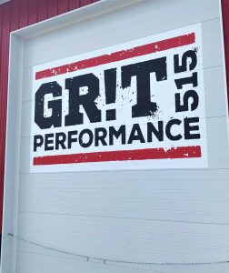 Vinyl cling sign on a garage door for Grit 515 Performance.