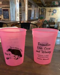 Pink to violet color change cups branded for winery.